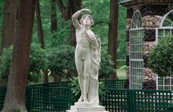 Antique marble statue in Peterhof lower park. Aviary Pavilion in the Lower Garden. Peterhof, Saint-Petersburg, Russia. Antique marble statue in Peterhof lower stock image