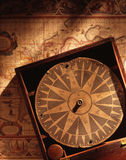 Antique Maritime Compass. With old map background Royalty Free Stock Photo