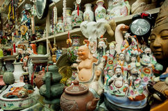 Antique market porcelain and old statues for sale at second hand store Royalty Free Stock Photos