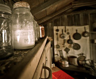 Antique Mason Jar in an Old Cabin. A Mason jar is a glass jar used in canning to preserve food. It was invented and patented by John Landis Mason, a Philadelphia Royalty Free Stock Images