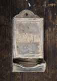 Antique matchbox. An antique matchbox mounted on wood Royalty Free Stock Image