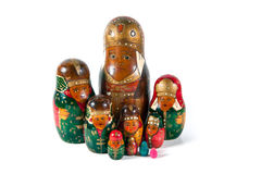 Antique matrioshka doll family. A family of an antique wooden matrioshka dolls Royalty Free Stock Photography