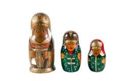 Antique matrioshka dolls. Antique wooden matrioshka dolls isolated on white background Royalty Free Stock Photos