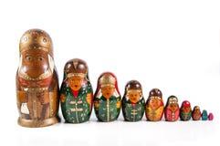 Antique matrioshka dolls. A row of an antique wooden matrioshka dolls Royalty Free Stock Images