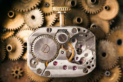 Antique mechanical hand watch macro view. rusty grunge textured metal gears background. Shallow depth of field, soft Royalty Free Stock Images