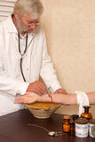 Antique medical procedure of letting blood Stock Photos