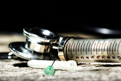 Antique medical tools on a wood background Royalty Free Stock Images