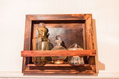 Antique medicinal glass bottles in antique cabinet royalty free stock photos
