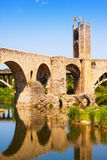 Antique medieval bridge with town gate Stock Photos