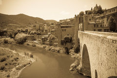 Antique medieval town with gate on bridge Royalty Free Stock Images
