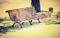 Antique metal bench on the park. Royalty Free Stock Photo