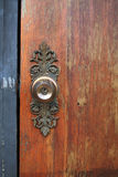 Antique metal knob on old wooden door Royalty Free Stock Photos