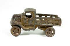 Antique metal toy truck. Metal antique toy truck, heavily rusted and worn Royalty Free Stock Photography