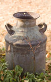 Antique Milk Can on farm. Horizontal Photo of an Antique Milk Can on farm with direct sunlight, foreground and background Royalty Free Stock Images