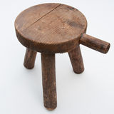 Antique milking stool Stock Photo