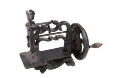 Antique minature hand crank sewing machine Royalty Free Stock Photo