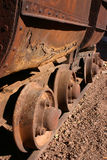 Antique Mining Car Wheels. Rusting wheels on an antique mining cars on rails in Tombstone Arizona Stock Photo