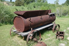 An antique mining tool at an outdoor museum Stock Images