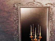 Antique mirror and candle holder. A large antique mirror and candle holder Royalty Free Stock Photography