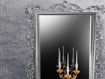 Antique mirror and candle holder Stock Images