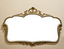Antique mirror on grunge wall Stock Photo