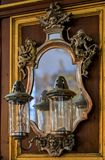 Antique mirror and lanterns in the German Church in Stockholm Sw. Stockholm, Sweden - August 14, 2017: Antique mirror and lanterns in the German Church, gothic stock image