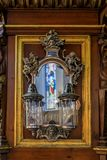 Antique mirror and lanterns in the German Church in Stockholm Sw. Stockholm, Sweden - August 14, 2017: Antique mirror and lanterns with the reflection of an royalty free stock image