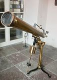 Antique mirror telescope. In university Royalty Free Stock Photography