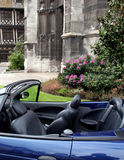 Antique and modern. Modern sports car in front of antique cathedral in French city stock photography