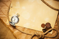 Antique money with watch and rope Stock Photography