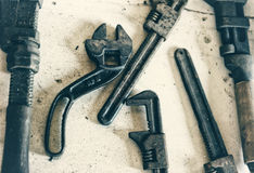 Antique Monkey Wrenches. Close up view of several monkey wrenches.  Process to give a retro/faded look Royalty Free Stock Images