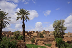 Antique Moroccan Kasbah Tamnugalt surrounded by palm Royalty Free Stock Photography