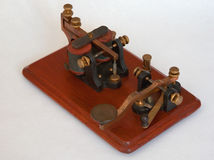 Antique Morse Key. View of a Camelback antique morse key dating from around 1860. It is complete with a buzzer. The whole assembly is known as a Key-on-base or royalty free stock photos