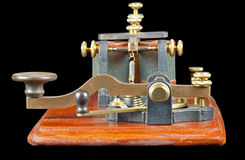 Antique Morse Key. An antique Morse key - type known as a Camelback as a result of the shape of the lever. It dates from around 1860 and has the associated royalty free stock photo