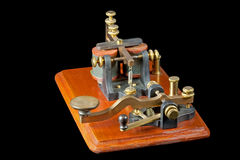 Antique Morse Key. An antique Morse key - type known as a Camelback as a result of the shape of the lever. It dates from around 1860 and has the associated royalty free stock images