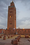 The antique mosque of Marrakech, Morocco, at sunset. Stock Image