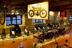 Antique motorcycles and vintage bicycles Stock Images