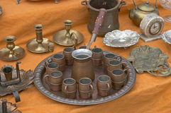 Antique mugs. On a table , for sell royalty free stock image