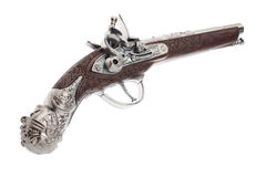 Antique musket on white background. The ancient pistol isolated on white background Royalty Free Stock Images