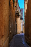 Antique narrow maltese street in Mdina Royalty Free Stock Photography