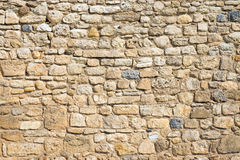 Antique natural stonewall. A beautiful ancient stone wall of an old castle Stock Images