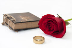 Antique notes and red rose with a golden ring Royalty Free Stock Photography