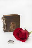 Antique notes and red rose with a golden ring Stock Images