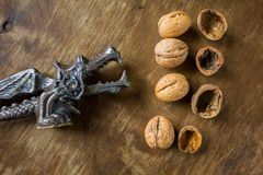 Antique nutcracker Dragon with walnuts Stock Photography