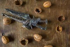 Antique nutcracker Dragon with walnuts Royalty Free Stock Photos