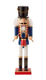 Antique Nutcracker Drummer isolated. Antique Nutcracker Drummer with a red drum. He has white hair and beard. He sports a black hat, with a blue coat and black Royalty Free Stock Images