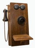 Antique Oak Wall Telephone Isolated. Western Electric antique crank style oak wall telephone.  All original with black painted bells, cloth cord and bakelite Royalty Free Stock Photography