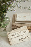 Antique objects. Antique letters, books and glass bottle Stock Photos