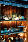 Antique objects on old wood shelf in Historic Shop. Antique household objects and collectible kitchen cooking items on old wood shelf Royalty Free Stock Image