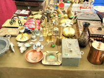 Antique objects for sale in a flea market Stock Photography